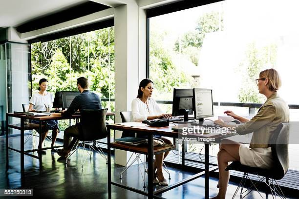 business people working in office - desktop pc stock photos and pictures