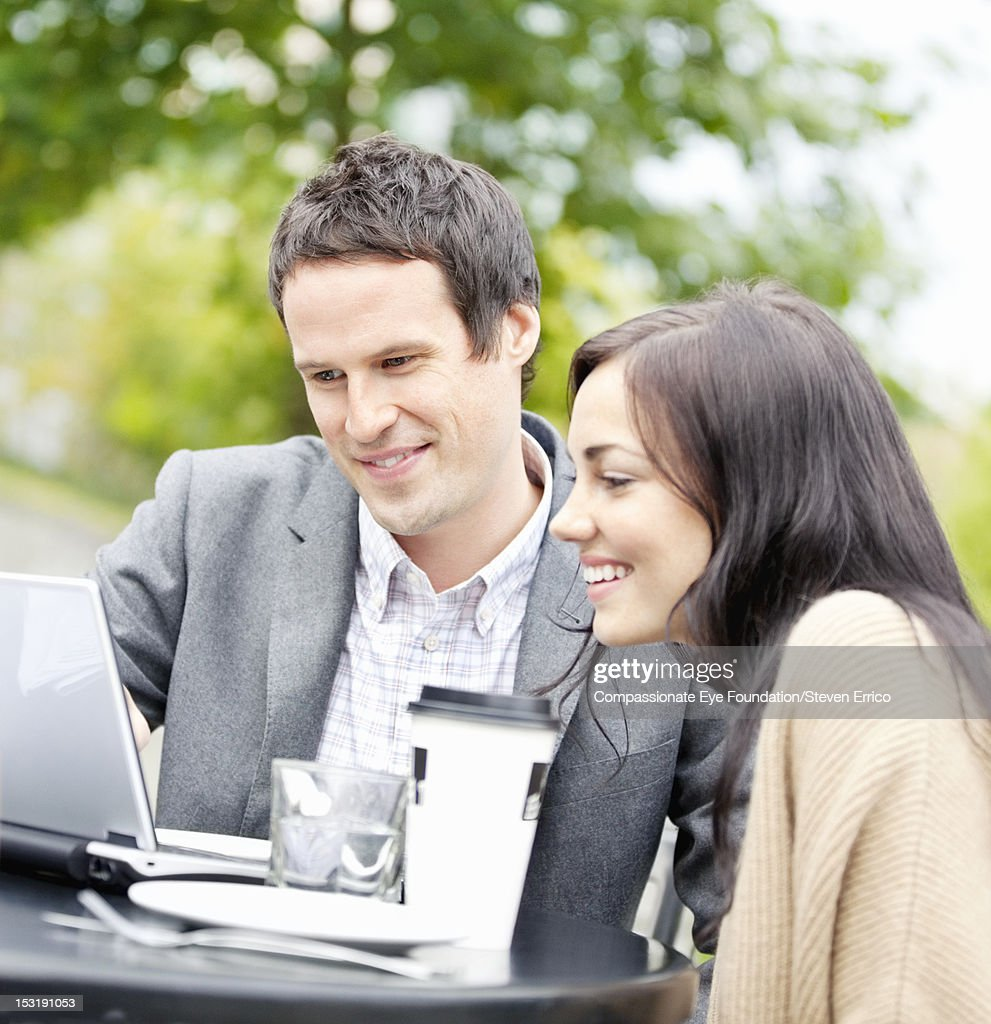 Business people working in outdoor cafe : Stock Photo