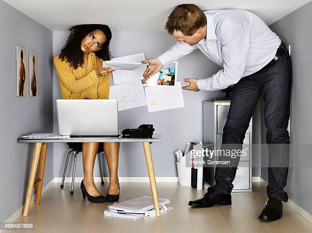 business people working in small office - claustrophobia stock photos and pictures