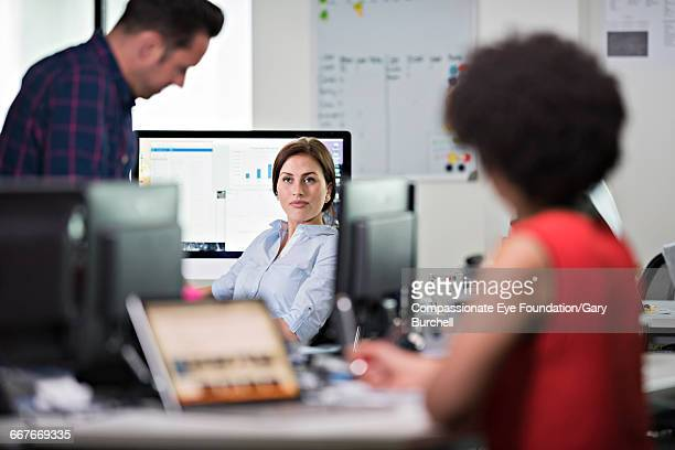 """business people working in tech start-up office - """"compassionate eye"""" stock pictures, royalty-free photos & images"""
