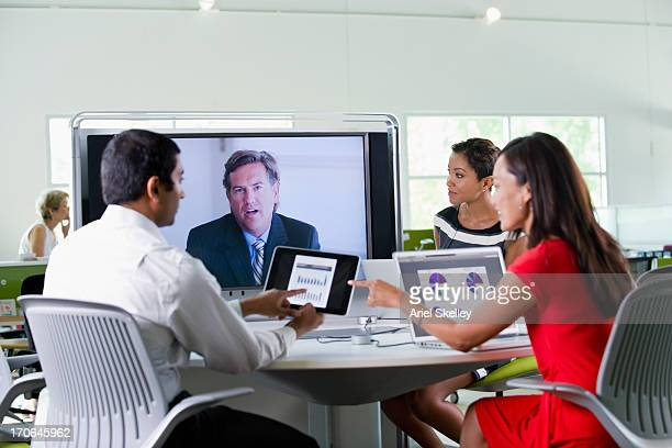 Business people working in teleconference
