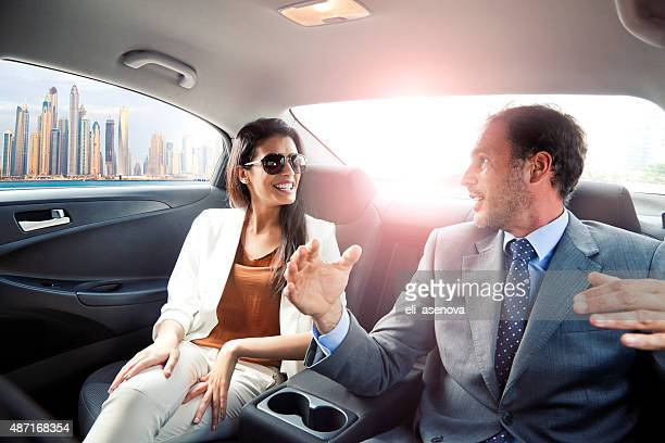 Business people working in the car in Dubai