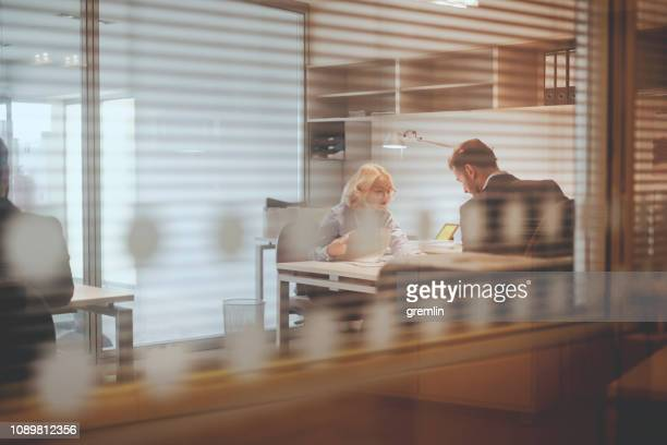 business people working in the office - glass magazine stock photos and pictures