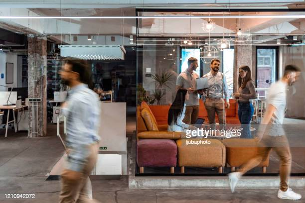 business people working in the office - medium group of people stock pictures, royalty-free photos & images