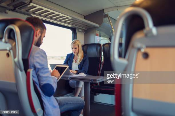 Business people working in the train