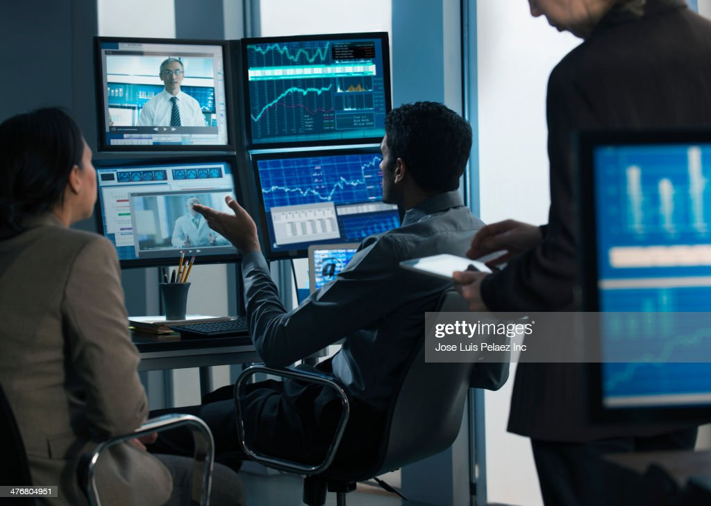 Business people working in video conference : Stock Photo