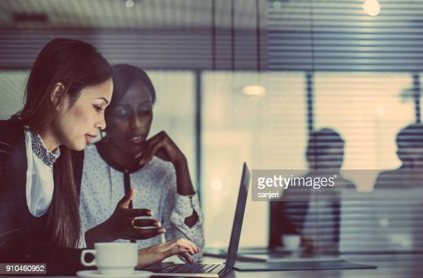 business people working late in office - human resources stock pictures, royalty-free photos & images