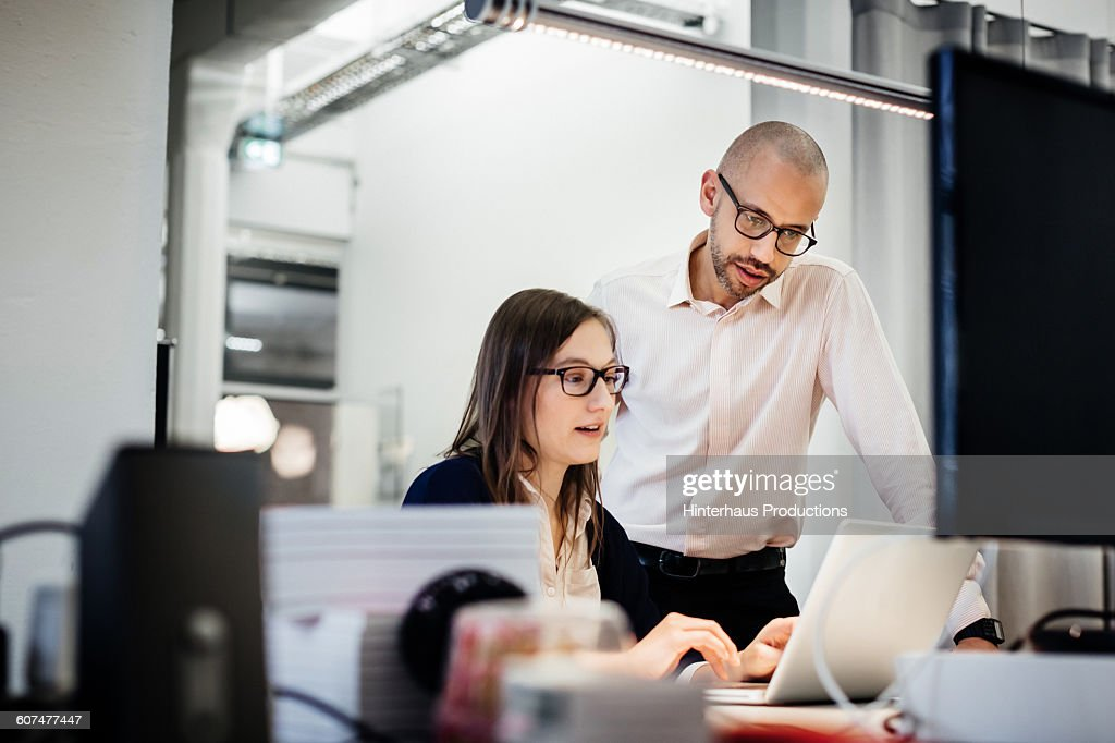 business people working late in office room : Stock Photo