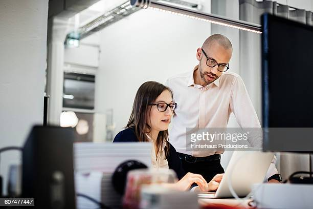 business people working late in office room