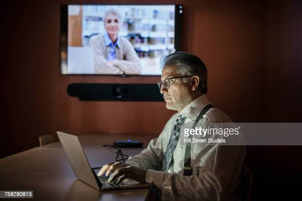 business people working late on video conference - mindzoom 2 stock pictures, royalty-free photos & images