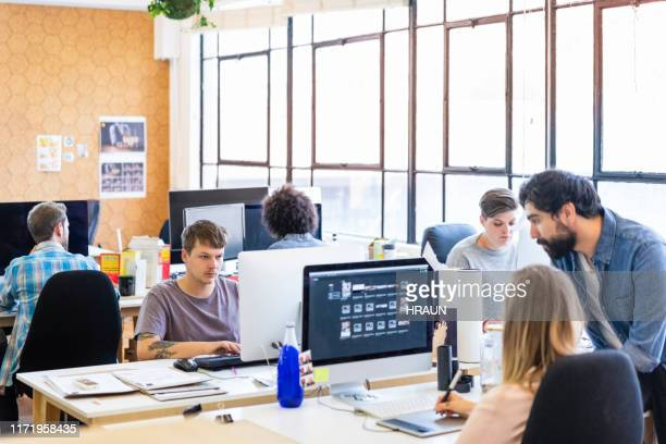 business people working on computers at office - animator stock pictures, royalty-free photos & images