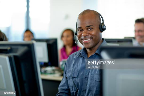 business people working on computers in call center - happy computer headset stock pictures, royalty-free photos & images