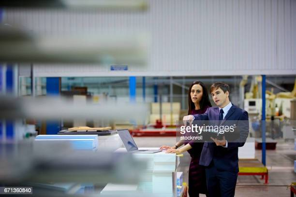 Business people working on factory production line