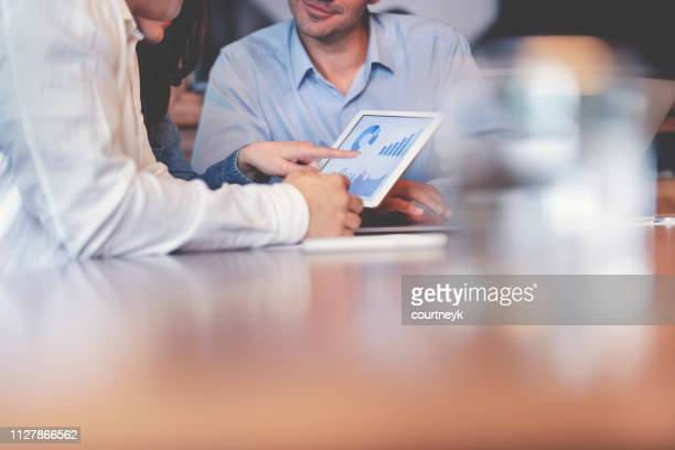 business people working on financial data on a digital tablet. - strategia foto e immagini stock