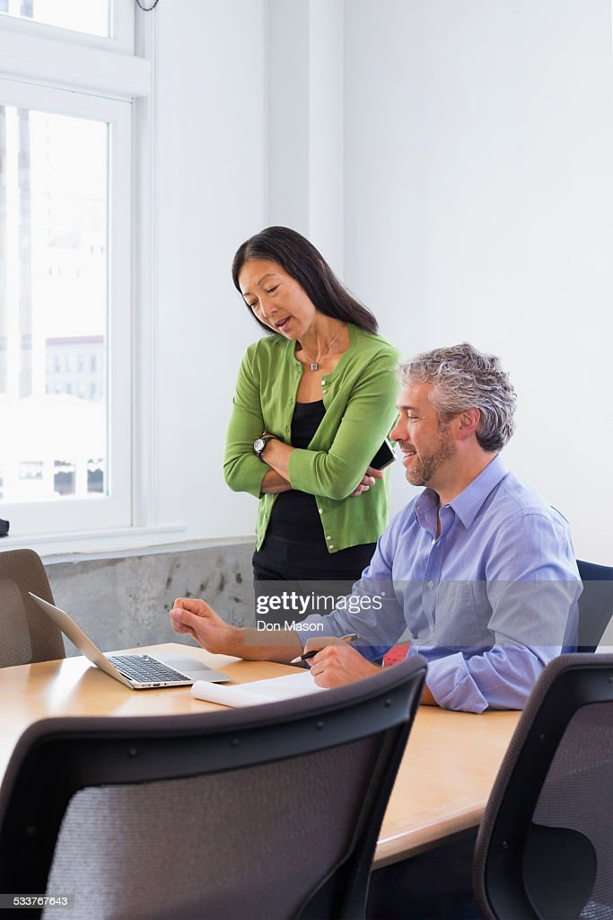Business people working on laptop in conference room : Foto stock
