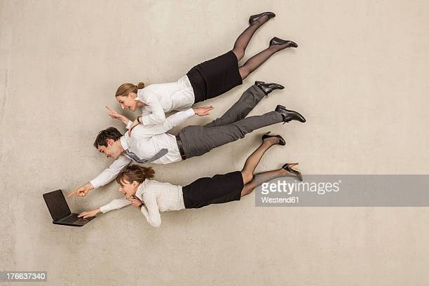 business people working on laptop in office - beige background stock pictures, royalty-free photos & images