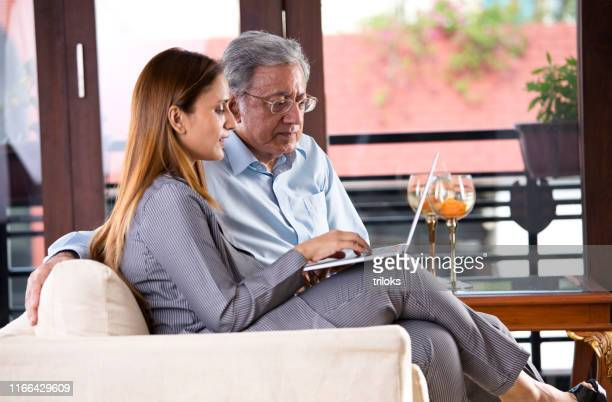business people working on laptop - mid adult stock pictures, royalty-free photos & images