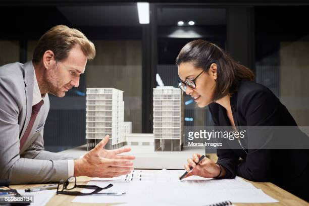 Business people working on plan at desk