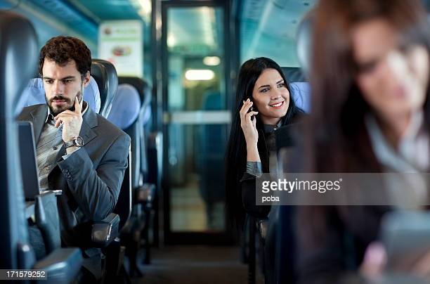 business people working  on the passenger  train - passenger train stock photos and pictures