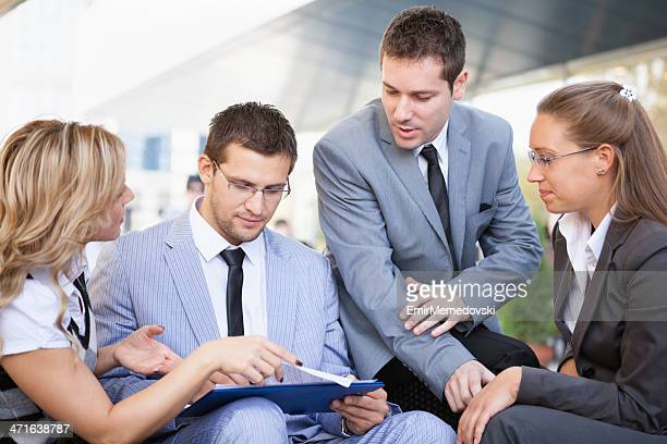 business people working outdoor - emir memedovski stock pictures, royalty-free photos & images