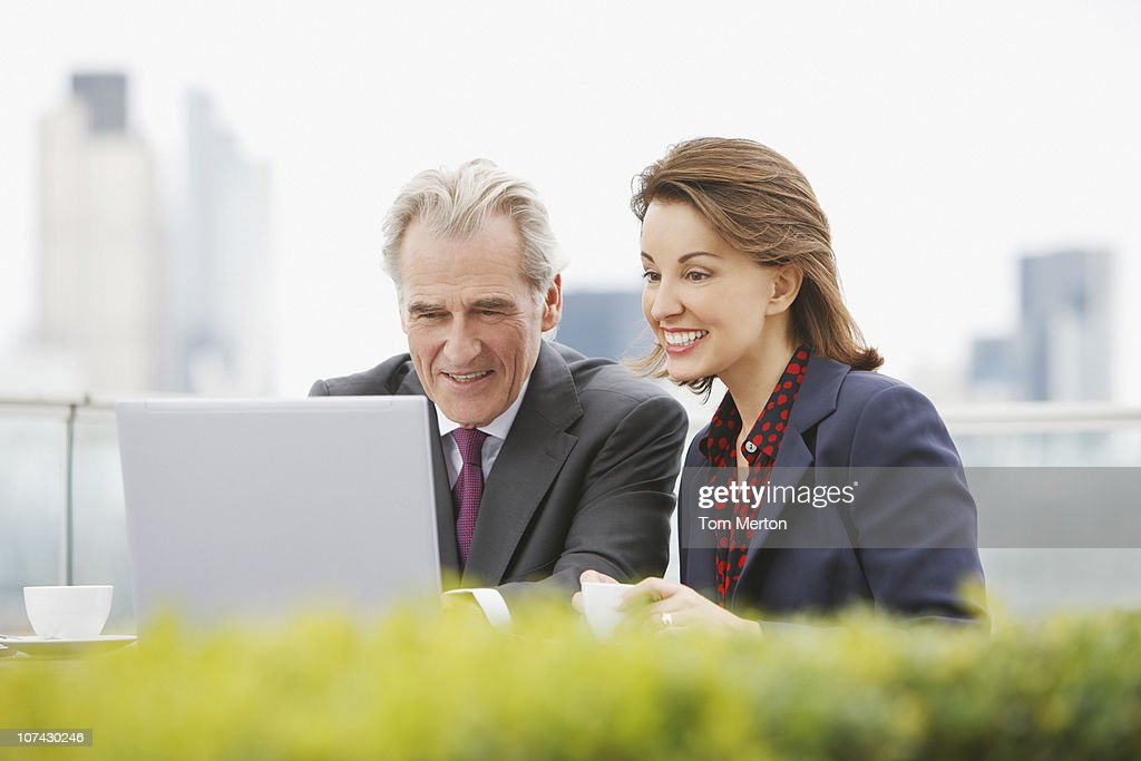 Business people working outdoors : Stock Photo