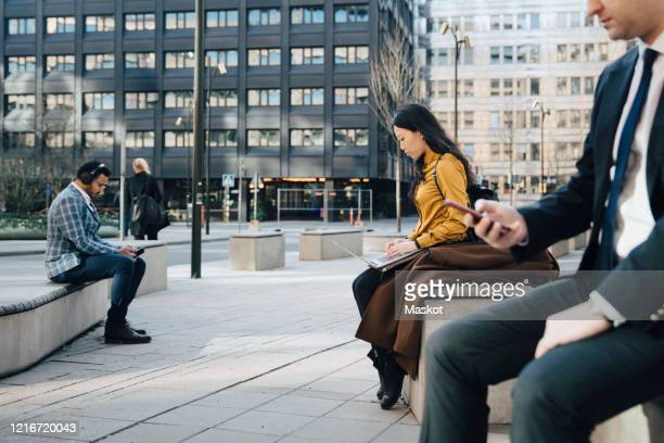 business people working outside keeping distance - big tech stock pictures, royalty-free photos & images
