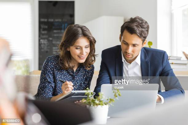 business people working together at coffee shop - discussion stock photos and pictures