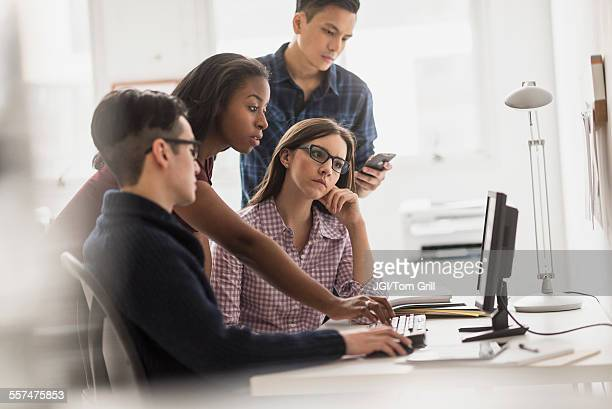 Business people working together at computer