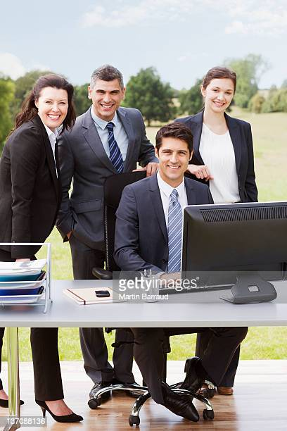 Business people working together at desk outdoors
