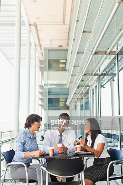 Business people working together in cafe