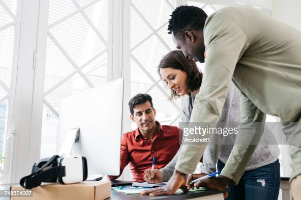 Business people working together in international office