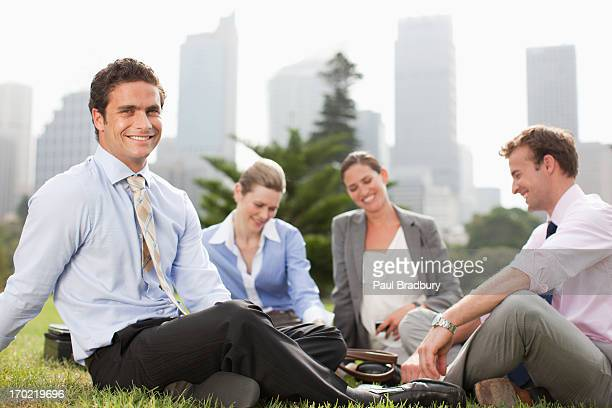 Business people working together in park