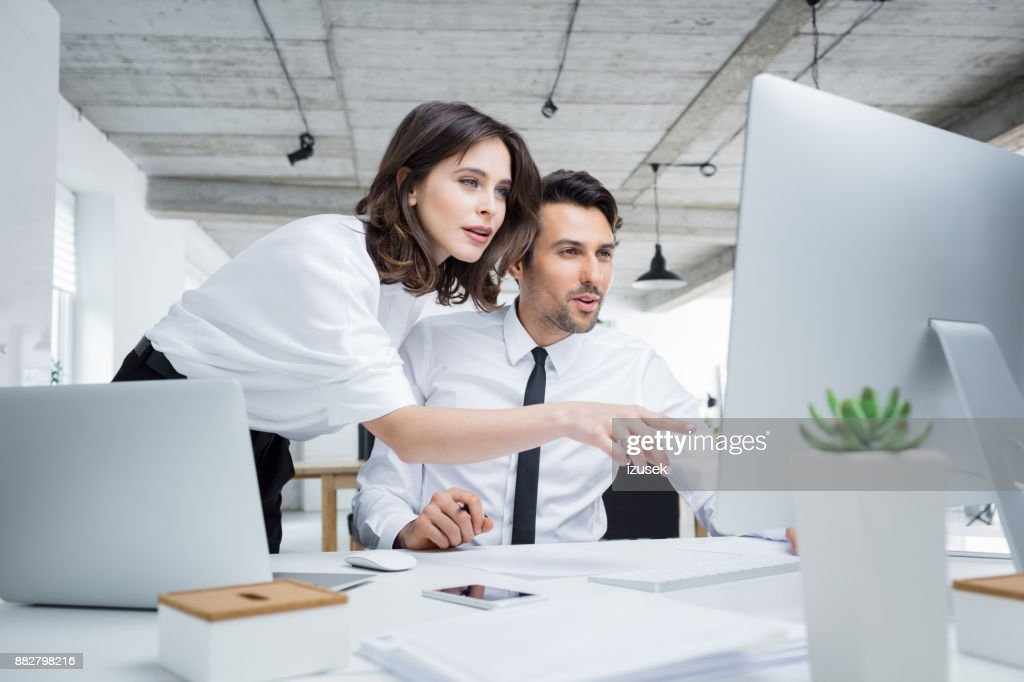 Business people working together on computer : Stock Photo