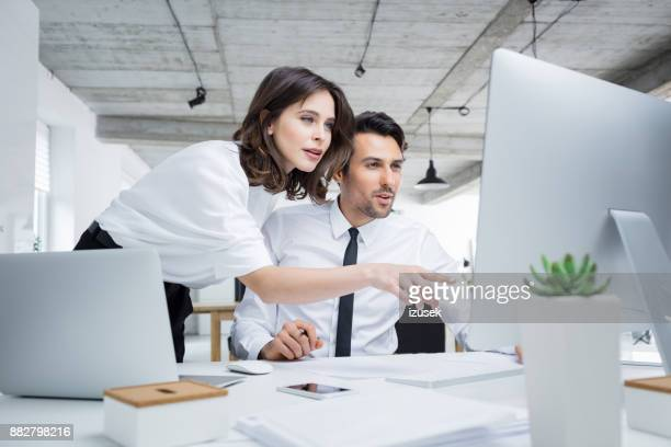 Business people working together on computer