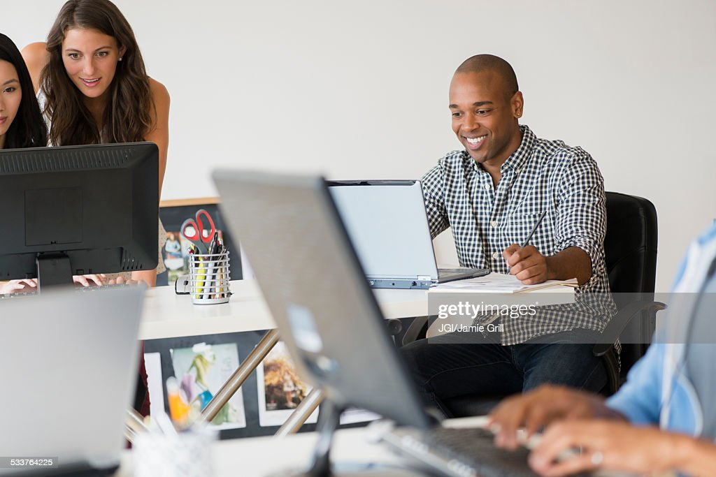 Business people working together on computers in office : Foto stock
