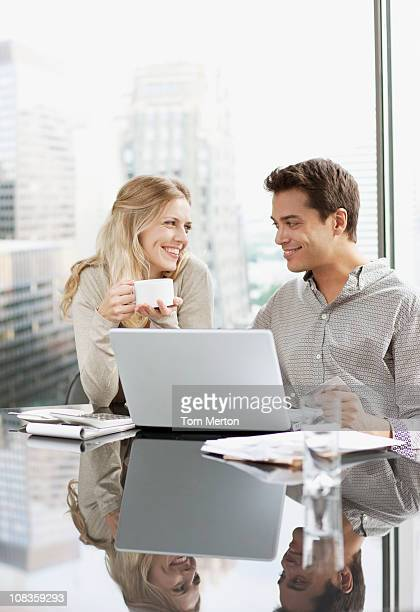business people working together on laptop - flirting stock pictures, royalty-free photos & images