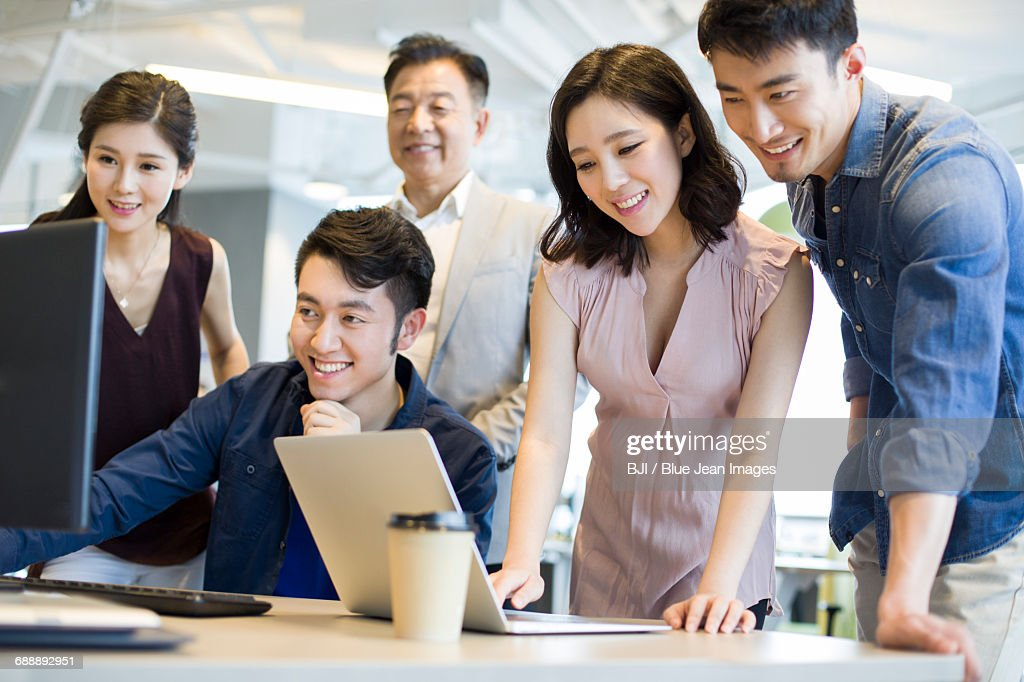 Business People Working Together With Computer And Laptop Stock