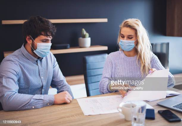 business people working with face mask. - social distancing stock pictures, royalty-free photos & images