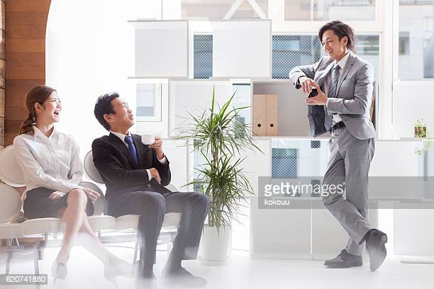 Business people you are chatting happily to break time