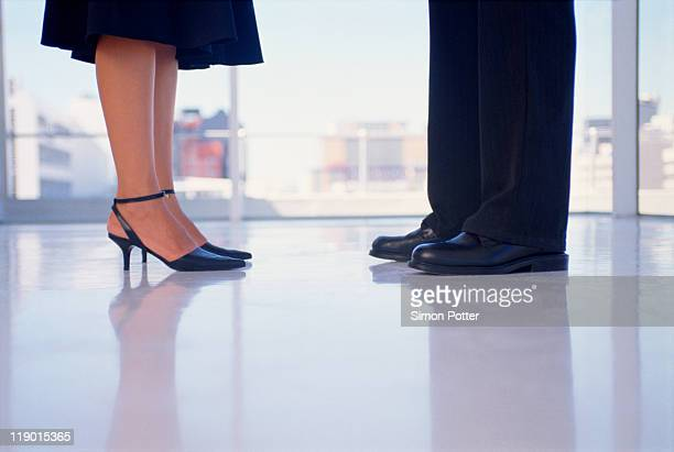 business peoples feet in office - human leg stock photos and pictures
