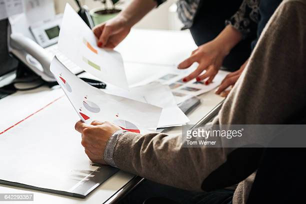 Business people's hands holding document
