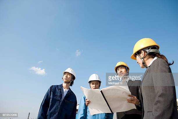 Business person and workers who work at port