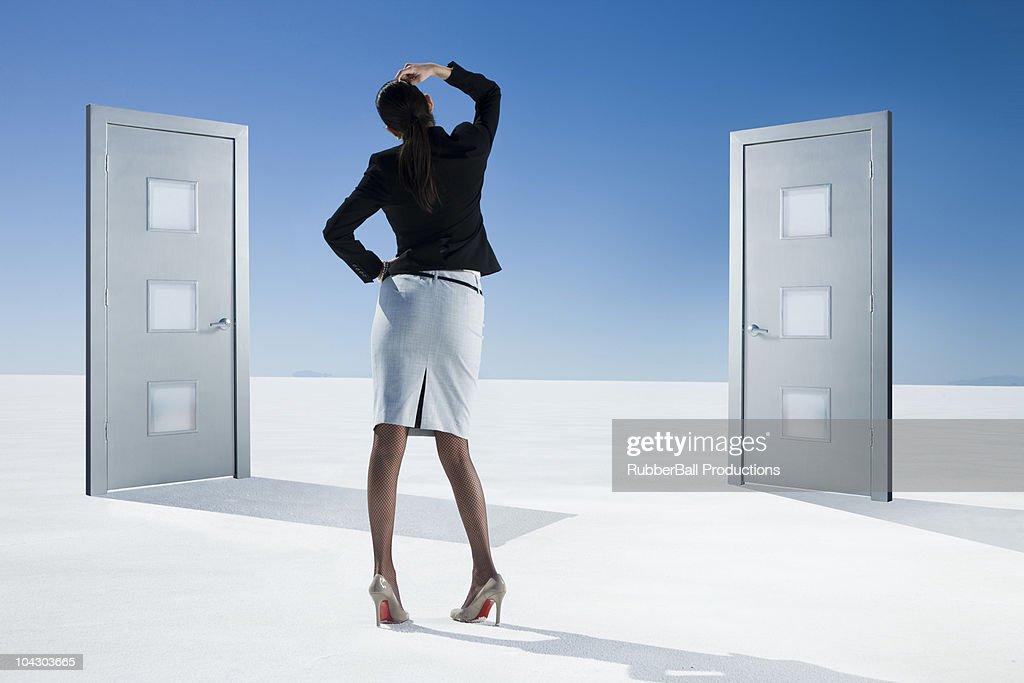 business person choosing between two doors : Stock Photo