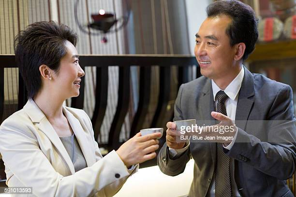 Business person drinking tea in tea room