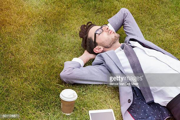 business person having break, laying in park. - fare una pausa foto e immagini stock