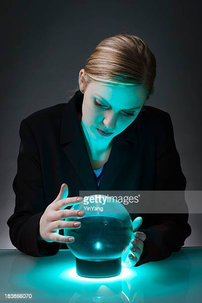 Business Person Looking into Crystal Ball to Forecast the Future