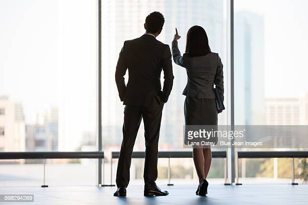 Business person looking through window
