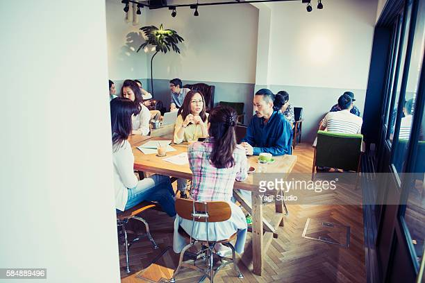 Business person meeting in a cafe