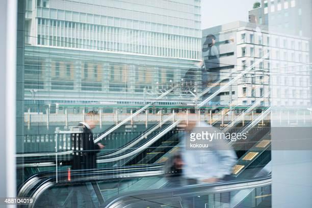 Business person on escalators