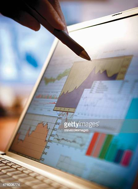 Business person pointing at financial chart.